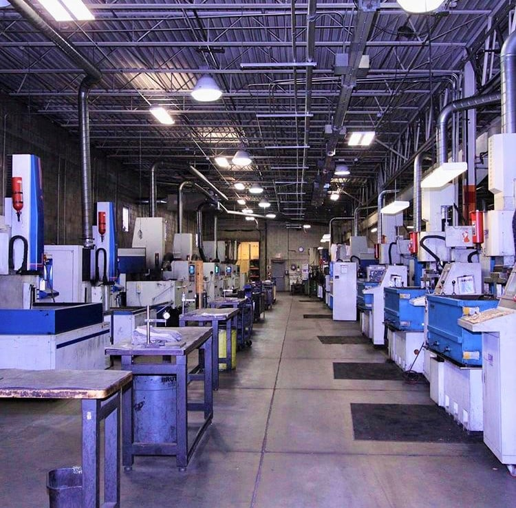 factory with two rows of precision machining equipment