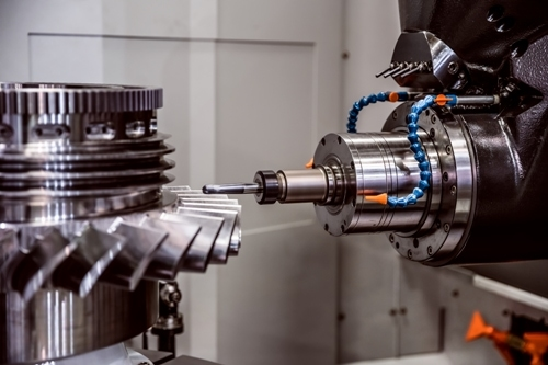 CNC milling machine cutting a metal turbine fan